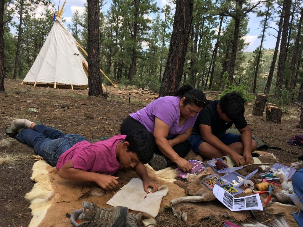 Choker making tipi in bkgrd Family